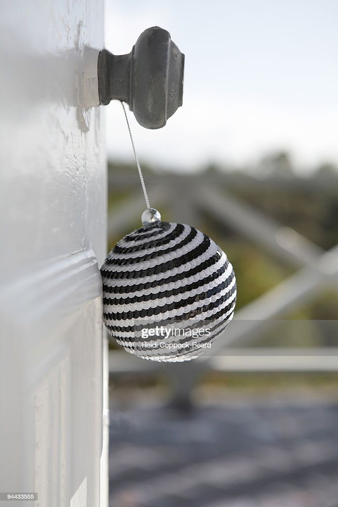 Christmas decoration on door handle : Stock Photo