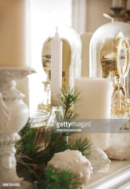 Christmas decoration on mantelpiece with candles