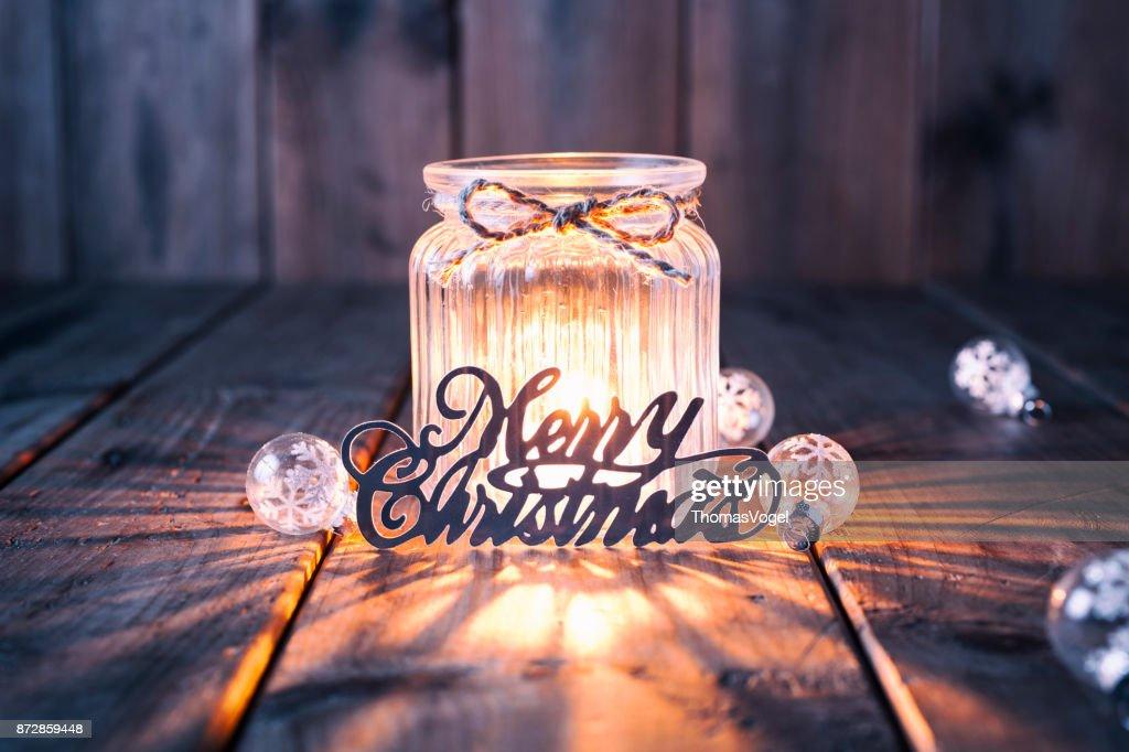 Weihnachtsdekoration auf altem Holz - Kerze Jar Karte : Stock-Foto