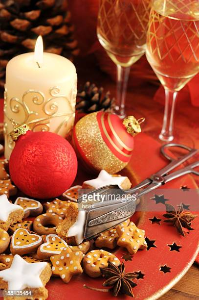 Christmas decoration on table wineglass candle cookies
