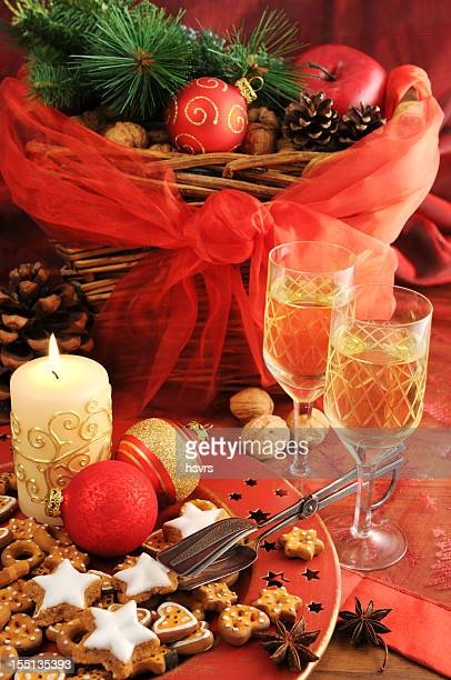 Christmas decoration on table with basket wineglass candle cookies