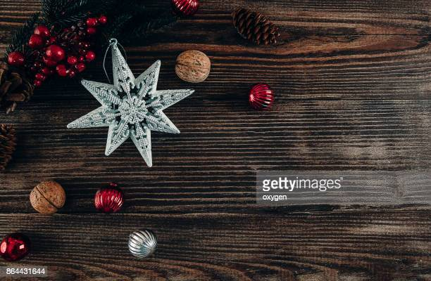 Christmas Decoration Star on Dark Wooden Background