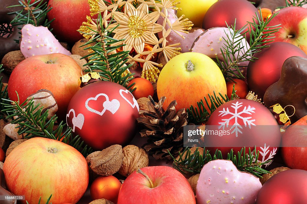 Christmas decoration with baubles apples nutes and cookies : Stock Photo