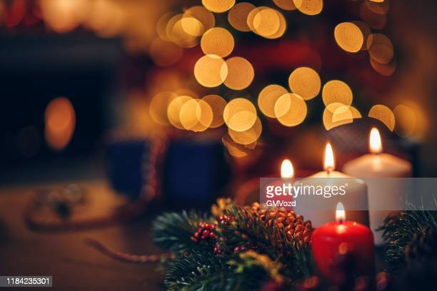 christmas decoration with candles and holiday lights - candlelight stock pictures, royalty-free photos & images