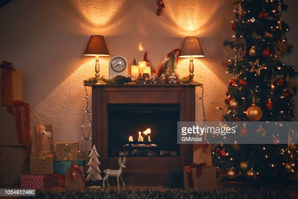 christmas decoration with christmas tree ornaments and holiday lights in a cozy atmosphere - camino foto e immagini stock