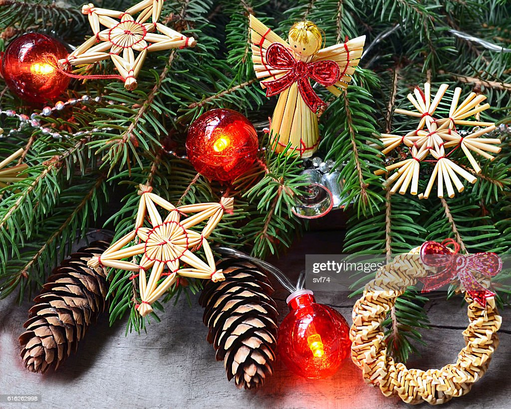 Christmas decoration with fir tree branches,garland lights,cones,toys. : Stock Photo