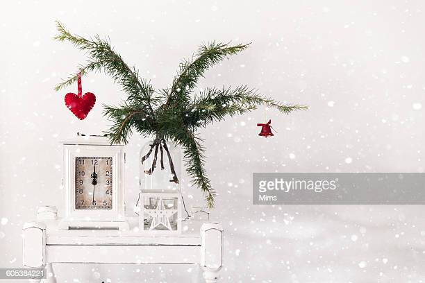 Christmas decoration with pine, clock and star lantern