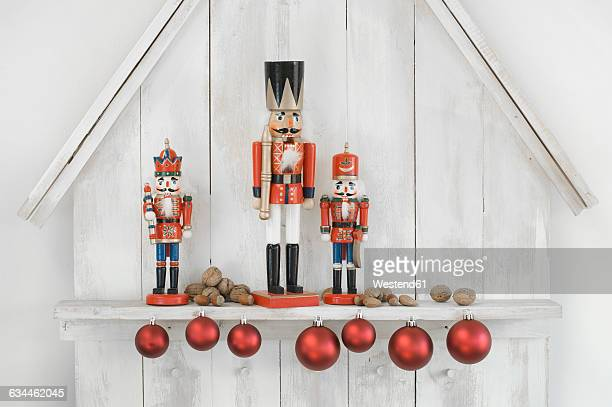 Christmas decoration with three nutcrackers, Christmas baubles and nuts