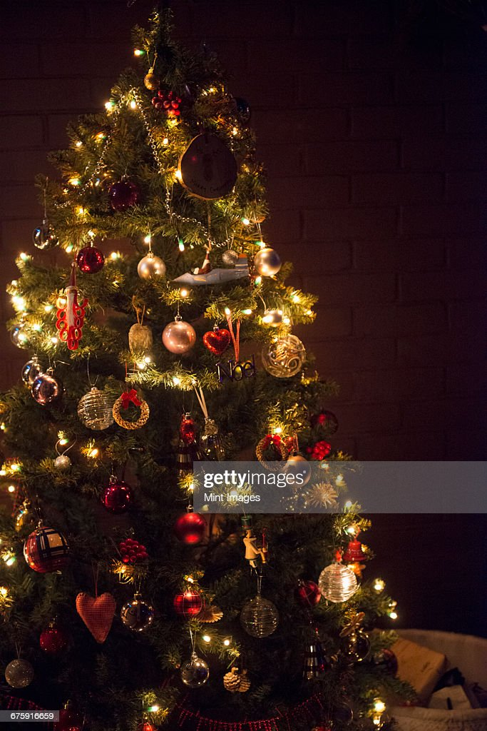 christmas decorations a traditional real christmas tree decorated with lights stock photo