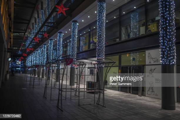 Christmas decorations adorn an empty Spitalfields market on November 21, 2020 in London, England. Many of London's bars, clubs and restaurants are...