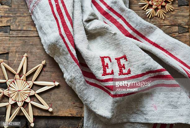 christmas decorations and a towel - dish towel stock pictures, royalty-free photos & images