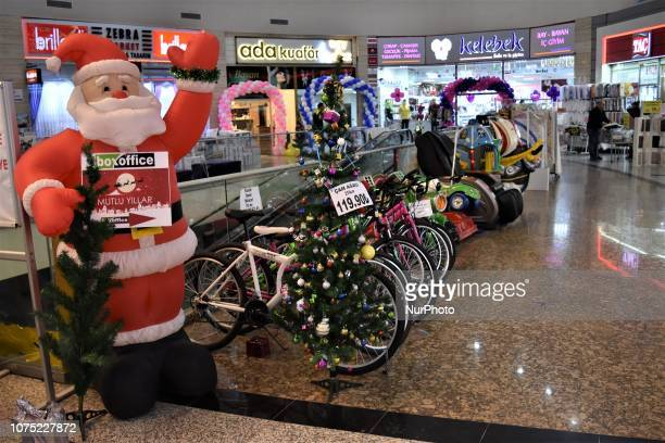 Christmas decorations and bicycles for sale are seen at a shopping center in Ankara Turkey on December 27 2018 A year is passed under economic...