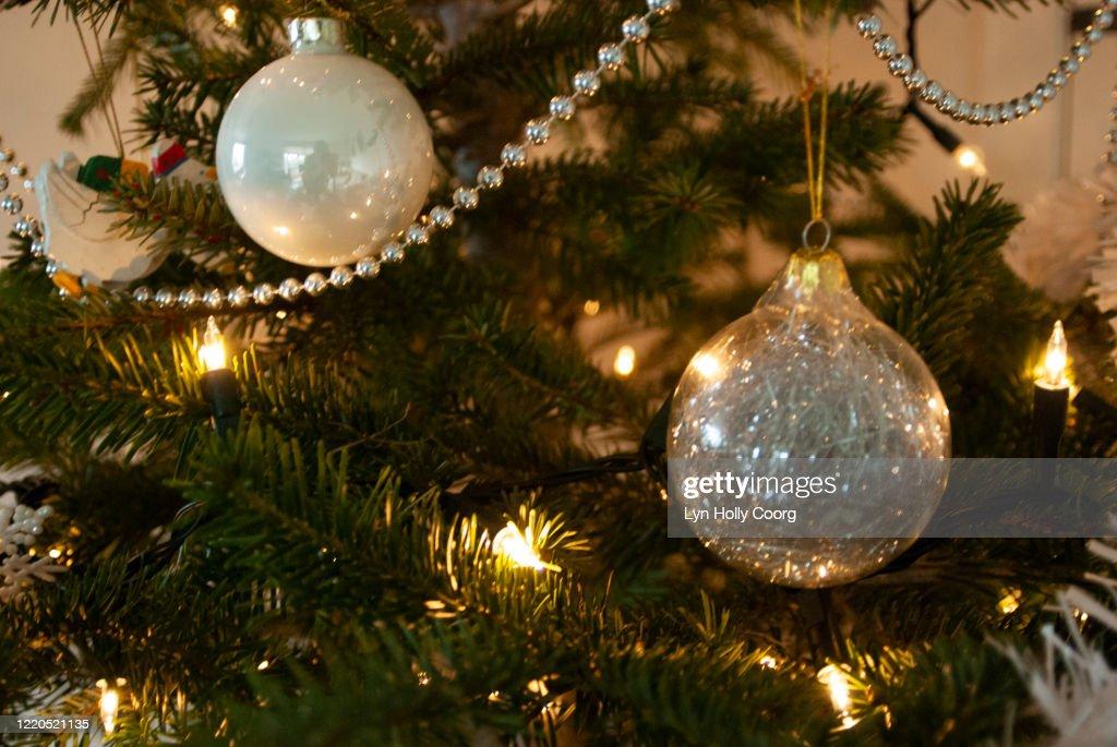Christmas decorations and garland on Christmas tree : Stock Photo