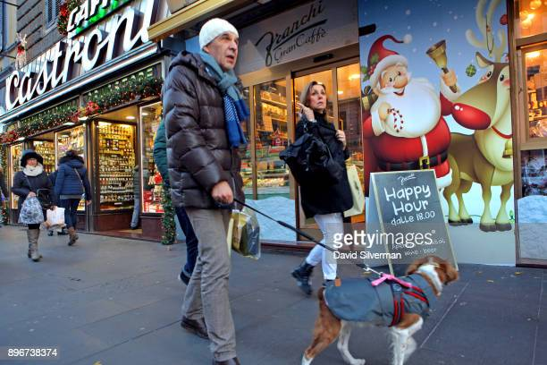 Christmas decorations and posters cover shop fronts on the popular Via Cola di Rienzo shopping street on December 9, 2017 in Rome, Italy. Despite...