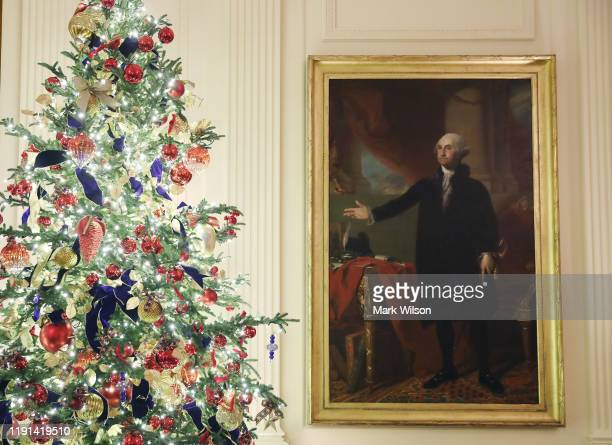 Christmas decorations are on display in the East Room at the White House December 2 2019 in Washington DC The White House expects to host 100 open...