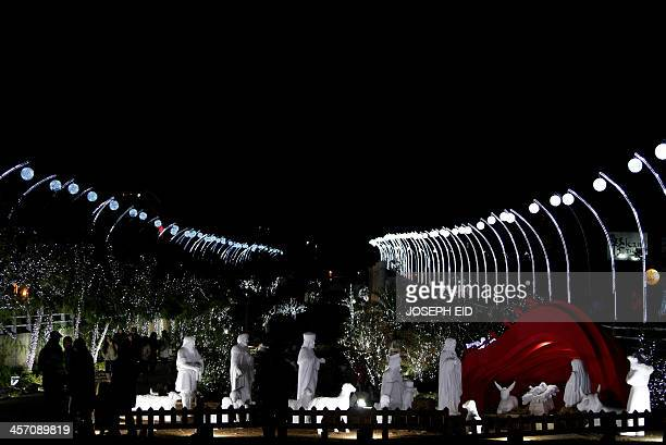 Christmas decorations are seen at the Lebanese historical coastal city of Byblos on December 16 2013 Pope Francis II said via Twitter ' We cannot...
