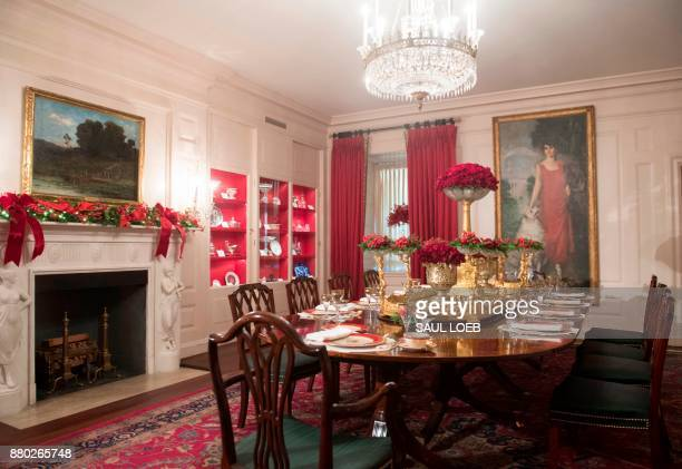 Christmas decorations are seen during a preview of holiday decorations in the China Room of the White House in Washington DC November 27 2017 / AFP...
