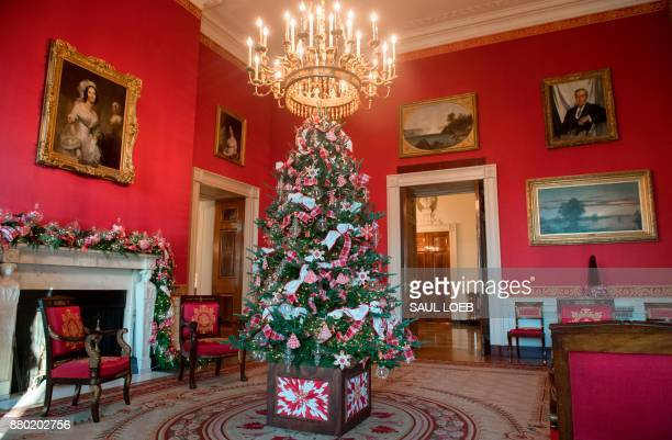Christmas decorations are seen in the Red Room during a preview of holiday decorations at the White House in Washington DC November 27 2017 / AFP...