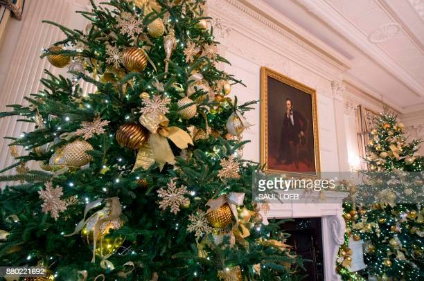 Christmas decorations are seen in the State Dining Room during a preview of holiday decorations at the White House in Washington DC November 27 2017...