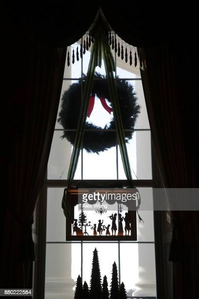 Christmas decorations are seen on a window of the Green Room at the White House during a press preview of the 2017 holiday decorations November 27...