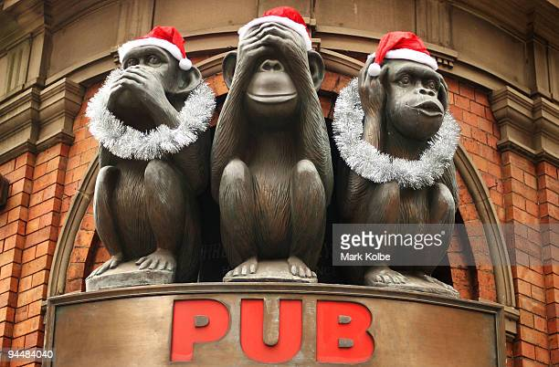 Christmas decorations are seen on the Monkeys at the entry to the 3 Wise Monkeys Pub on George street as Sydney prepares for Christmas on December 15...