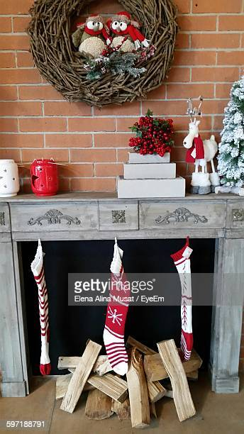 christmas decorations at fireplace - alina stock pictures, royalty-free photos & images