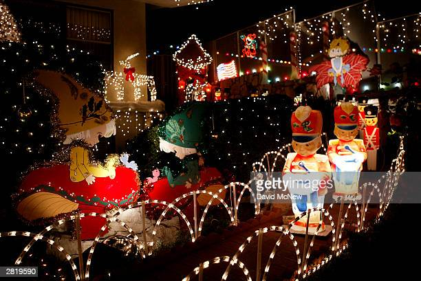 christmas decorations fill a yard are seen on december 17 2003 in pasadena california many of