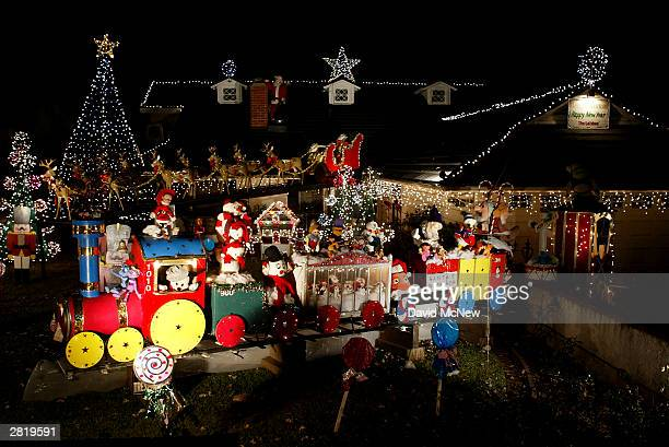 christmas decorations filling a yard includes a large toy train are seen on december 17 2003