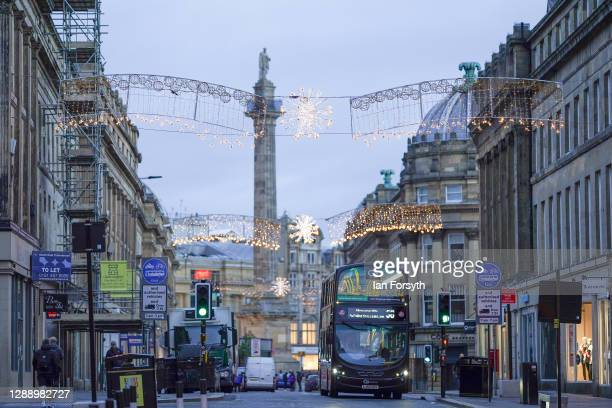 Christmas decorations hang above the streets in Newcastle city centre on December 02, 2020 in Newcastle upon Tyne, England. Today is the first day of...