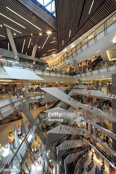 Christmas decorations hang in the atrium of the newly refurbished Myer Holdings Ltd Melbourne City store in Melbourne Australia on Thursday Nov 24...