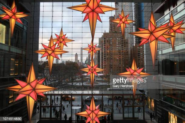 Christmas decorations hang inside the lobby of the Time Warner Center in Columbus Cirlce on November 28 in New York City.