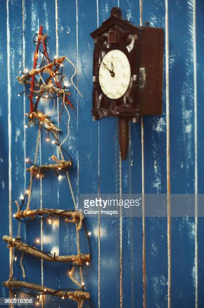 Christmas decorations hanging on blue wooden wall