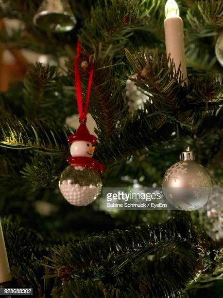 Christmas Decorations Hanging On Tree