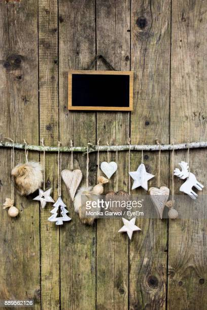 Christmas Decorations Hanging On Wooden Wall