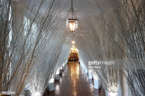 Christmas decorations in a hallway of the East Wing of the White House during a press preview of the 2017 holiday decorations November 27 2017 in...