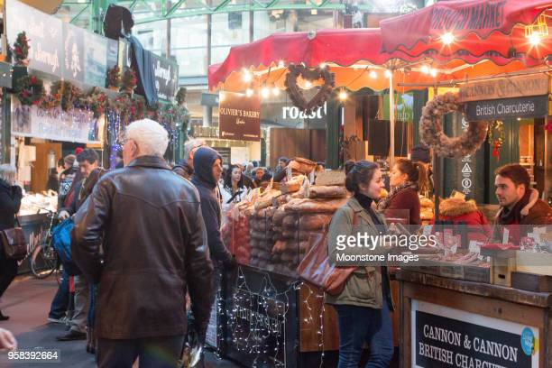 christmas decorations in borough market, london - borough market stock pictures, royalty-free photos & images