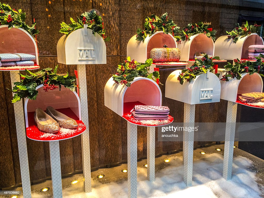 christmas decorations in window display of a store milan stock photo