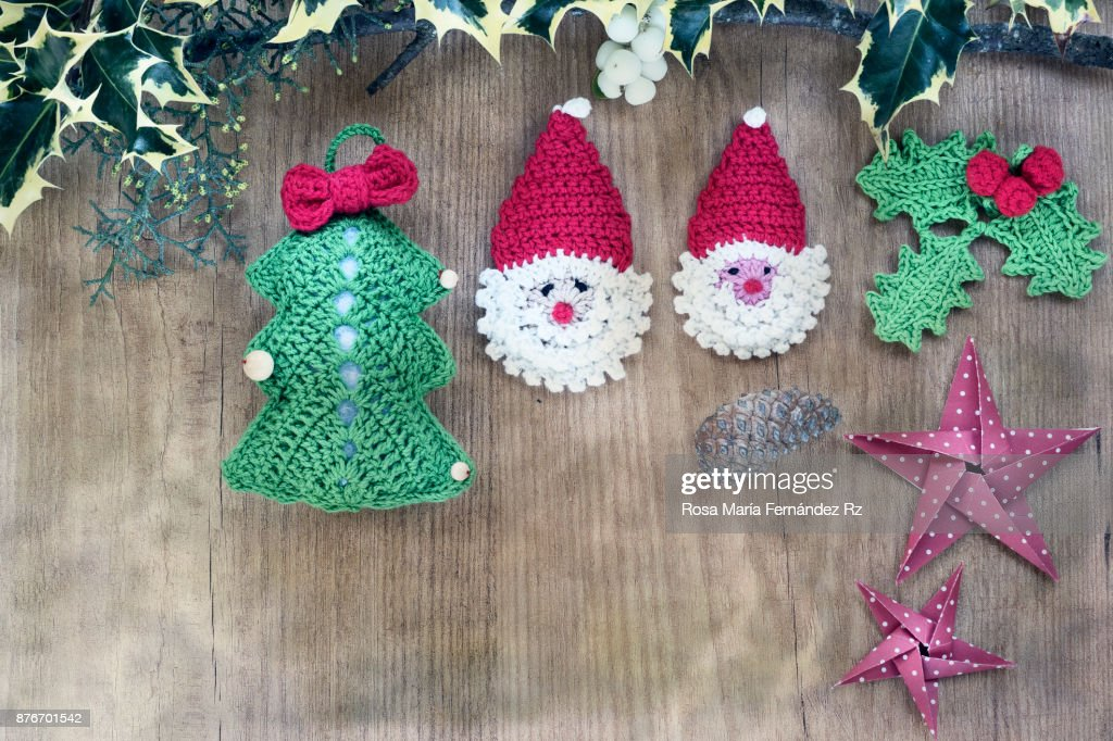 Christmas Decorations Made In Crochet And Origami Framed With Holly