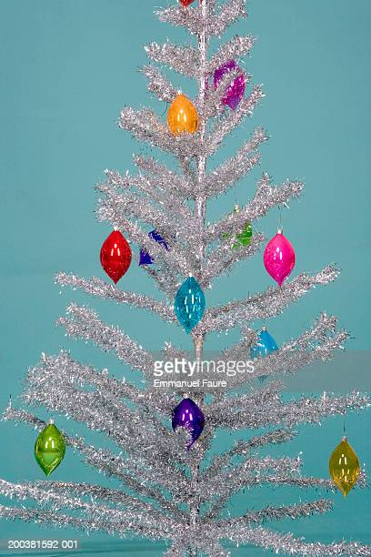 Christmas decorations on artificial tinsel tree