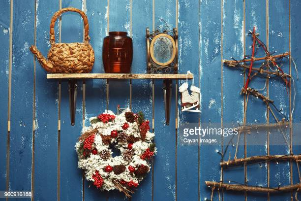 Christmas decorations on blue wooden wall