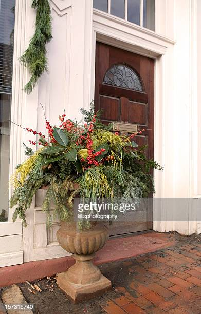 christmas decorations on front porch of home - pot plant stock pictures, royalty-free photos & images