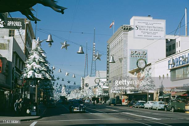 Christmas decorations on Hollywood Boulevard in Hollywood Los Angeles California Warner Hollywood Theatre later the Hollywood Pacific Theatre is in...