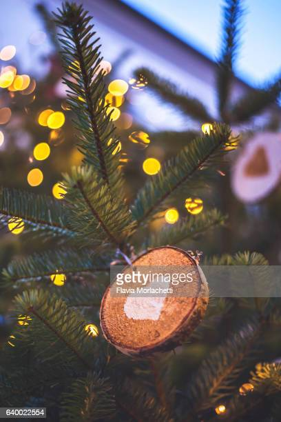 Christmas decorations on trees in Pergine Valsugana, Italy