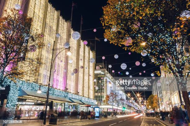 christmas decorations, oxford street, central london - oxford street london stock photos and pictures