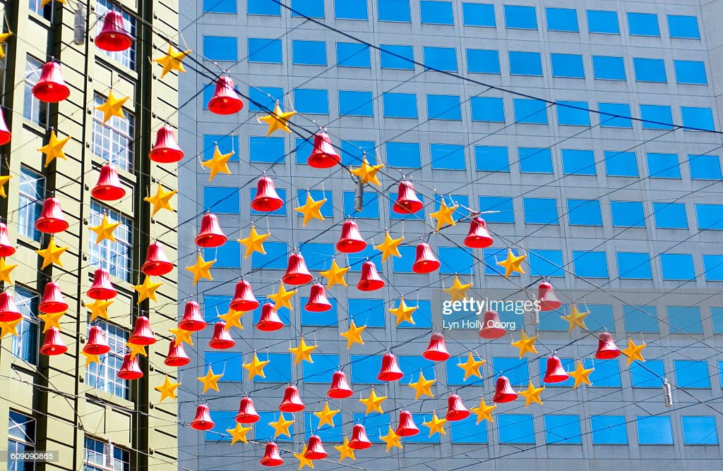 Christmas decorations with backdrop of buildings : Stock Photo