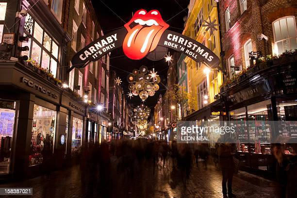 Christmas decorations with the theme of 'The Rolling Stones' light up Carnaby Street in central London on December 14 2012 Areas of central london...