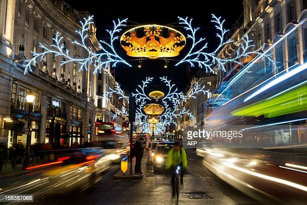 Christmas decorations with the theme of 'The Twelve Days of Christmas' light up Regent Street in central London on December 14 2012 Areas of central...