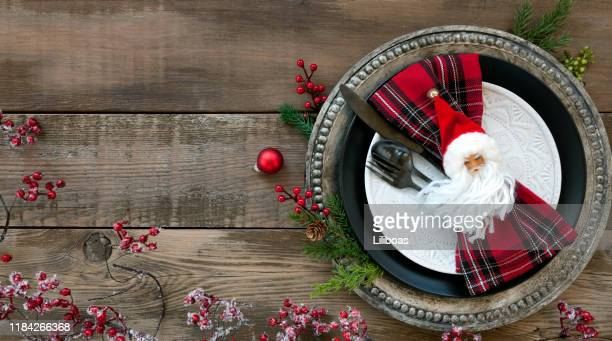 christmas dining plate on an old wood table - country christmas stock pictures, royalty-free photos & images