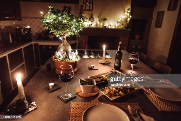 christmas dinner at home - romanticism stock pictures, royalty-free photos & images