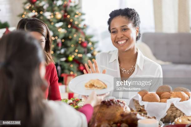 christmas dinner guest declines dessert - refusing stock pictures, royalty-free photos & images